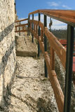 New balustrade at rock monastery Stock Photo