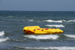 New banana boat. New banana boat parked in the waves Stock Image