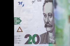 New banknote denomination of 20 UAH. Ukrainian money close up. Fragment of banknotes stock image