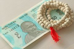 A new banknote of India with a denomination of 50 rupees. Indian currency. Mahatma Gandhi and rosary, beads of Tulasi tree.  royalty free stock image