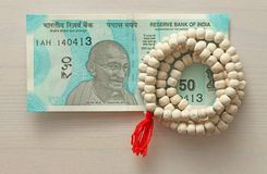 A new banknote of India with a denomination of 50 rupees. Indian currency. Mahatma Gandhi and rosary, beads of Tulasi tree.  royalty free stock photo