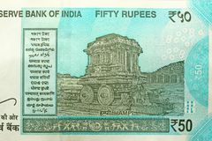A new banknote of India with a denomination of 50 rupees. Indian currency. The other side, Hampi`s chariot.  stock images