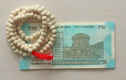 A new banknote of India with a denomination of 50 rupees. Indian currency. The other side, Hampi`s chariot and rosary, beads of. Tulasi tree royalty free stock photo