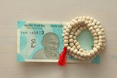 A new banknote of India with a denomination of 50 rupees. Indian. Currency. Mahatma Gandhi and rosary, beads of Tulasi tree Stock Images