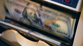 New banknotes checked on a counting machine. 4K stock footage