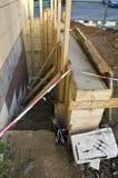 New base foundation near house construction Royalty Free Stock Images