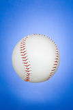 New baseball. Clean, new baseball against blue gradient background stock image