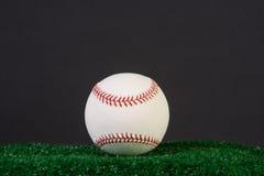 New baseball on black background Stock Image