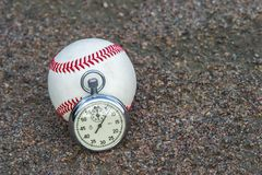 New baseball with an old sport stopwatch royalty free stock photos