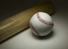 New baseball and wooden bat in light Stock Photo
