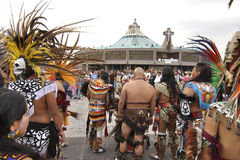 New basilica Mexico City. MEXICO CITY - DECEMBER 12, 2012:  Aztec dancers in traditional costumes gather in front of the new basilica of Our Lady of Guadalupe in Stock Photography