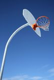 New basketball backboard and clear sky. Perfect day for playing basketball stock images