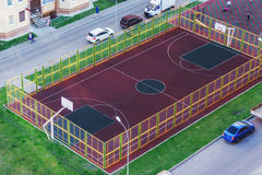 New Basketball Court In the courtyard of residential buildings Royalty Free Stock Photo