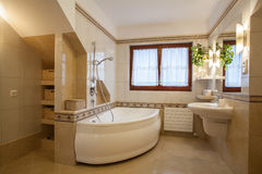 New bathroom. Bathroom in beige and creamy colors, modern house Royalty Free Stock Photos