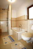 New bathroom in beige brown colours Royalty Free Stock Image