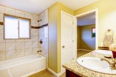 New bathroom interior with cherry sink cabinet. Stock Photo