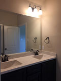 New bathroom with two sinks and mirror. Nice new bathroom ,two sinks and big mirror on the wall , TX USA royalty free stock photography