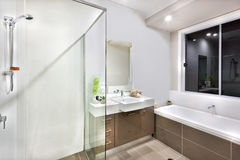New bathroom with washing area, including bath tub Royalty Free Stock Images