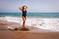 Free New Beach Fashion. Girl In A Protective Mask In Swimsuit And Hat. Royalty Free Stock Photo - 192878705