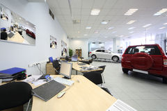 New beautiful cars stand in big office of shop Stock Photos