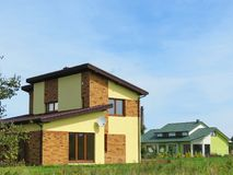 New beautiful homes in summer, Lithuania. New beautiful homes in Silute town, Lithuania Stock Photos