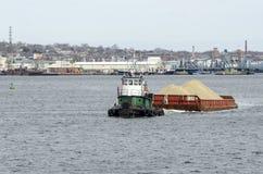 Tug Bucky towing sand barge Stock Image