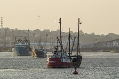 Fishing boats coming and going royalty free stock photo