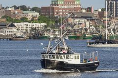 Lobster boat Green Dragon under way stock image