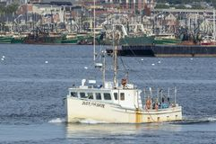 Lobster boat Just for Spite leaving New Bedford. New Bedford, Massachusetts, USA - August 25, 2018: Lobster boat Just for Spite crossing New Bedford inner harbor royalty free stock photography