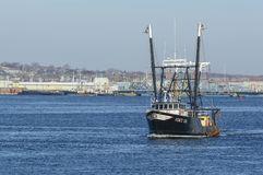 Fishing boat Stacy Lee on Acushnet River. New Bedford, Massachusetts, USA - February 19, 2018: Commercial fishing vessel Stacy Lee crossing New Bedford harbor Royalty Free Stock Images
