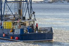 Commercial fishing boat Max & Emma leaving New Bedford. New Bedford, Massachusetts, USA - January 9, 2018: Commercial fishing vessel Max & Emma, hailing port stock photography