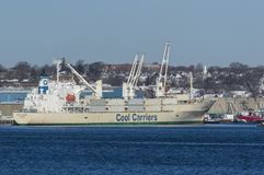 Wild Cosmos unloading in New Bedford. New Bedford, Massachusetts, USA - January 31, 2018: Refrigerated cargo ship Wild Cosmos docked in New Bedford harbor stock photography