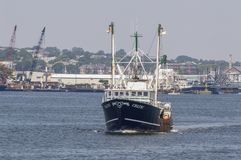 Commercial fishing boat Celtic heading to sea Stock Photo