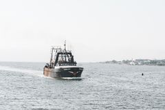 Commercial fishing vessel Tremont in New Bedford outer harbor Royalty Free Stock Photography