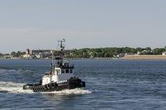 Tug Kodiak returning to New Bedford. New Bedford, Massachusetts, USA - June 12, 2018: Tug Kodiak making its way across New Bedford outer harbor stock photos