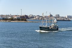 F/V Seven Seas heading for Buzzards Bay. New Bedford, Massachusetts, USA - March 31, 2018: Commercial fishing vessel Seven Seas with New Bedford waterfront in Stock Images