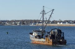 Dragger Ruthie B. heading out to sea Stock Images