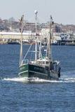 Fishing vessel Seven Seas on Acushnet River. New Bedford, Massachusetts, USA - March 31, 2018: Fishing vessel Seven Seas with New Bedford waterfront in Stock Photo