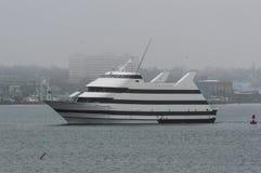 Spirit of Boston on foggy day. New Bedford, Massachusetts, USA - March 30, 2018: Spirit Cruises` Spirit of Boston leaving New Bedford on a foggy morning Stock Image