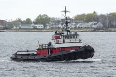 Tug Morgan returning to port. New Bedford, Massachusetts, USA - May 3, 2019: Tug Morgan heading back to New Bedford royalty free stock photo