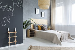 New bedroom with chalkboard. New, grey bedroom with chalkboard and double bed stock photography