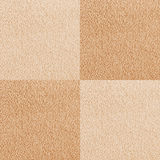 New beige checkered carpet texture Stock Images