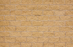 New beige sandstone wall. Beige sandstone wall with lighter concrete grouting a good background with room for overlaid text, type, sign, poster or Graffiti Royalty Free Stock Image