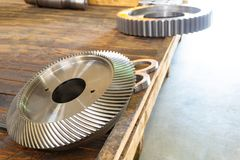 New bevel gear on the shelf after production.  royalty free stock images