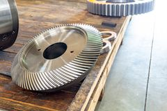 New bevel gear on the shelf after production.  stock photography
