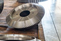 New bevel gear on the shelf after production.  royalty free stock photography