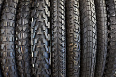 New bicycle tires with different tread. Close-up Stock Photography