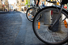 New bike wheels on ancient cobblestones Stock Photography