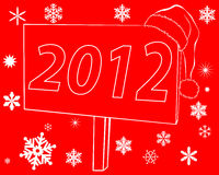 New billboards with the inscription 2012. New billboard that says 2012 on a red background with snowflakes Royalty Free Stock Images