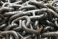 The new black anchor chain. In stock shipyard stock photo